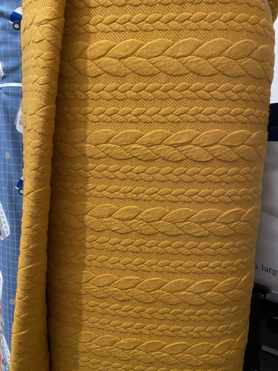 Mustard cable knit fabric